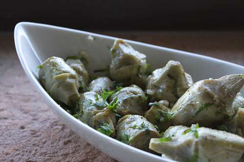 Artichokes braised in wine and olive oil are tender and full of flavor.