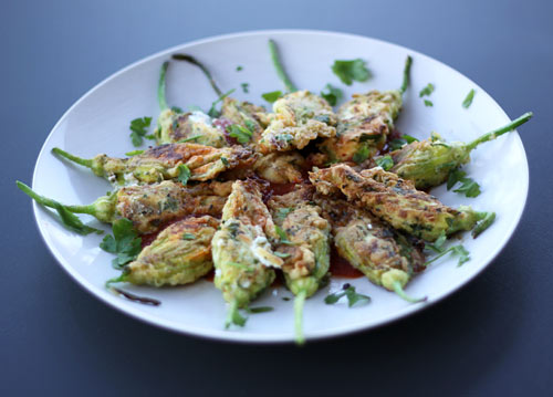 A light, creamy stuffing inside crispy, golden brown zucchini flowers.