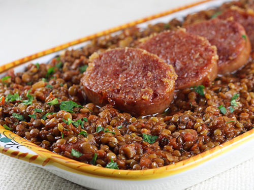 Historically served on New Year's Eve or New Year's Day, the round shape of the lentils represent coins which is supposed to bring prosperity for the upcoming year.