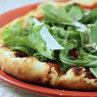 Marinara Pizza With Arugula And Shaved Parmesan