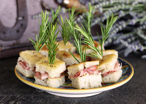 Tender squares of focaccia are stuffed with mortadella in this easy appetizer or snack option.