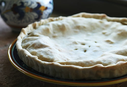 This is a very rustic, savory pie with a crust made simply with flour, olive oil, white wine and a little salt that could be found in southern Italy.