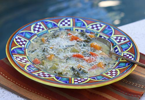 A mixture of egg and cheeses enriches a basic vegetable soup.