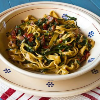 Spicy Fettuccine With Dandelion Greens, Sun-dried Tomatoes, & Pancetta