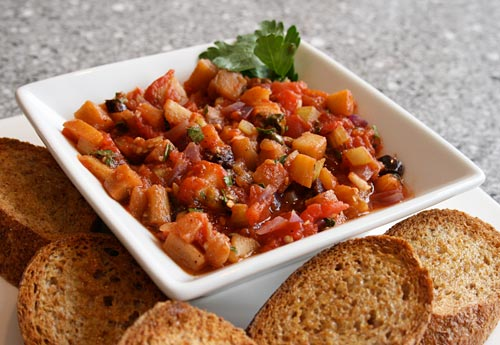 This Sicilian specialty combines a selection of Italian vegetables cooked together in a tomato sauce.