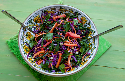 A healthy raw salad made with kale, red cabbage & other veggies.