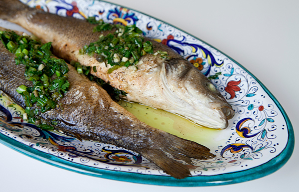 Roasting fish in the oven whole keeps the flesh tender and moist.
