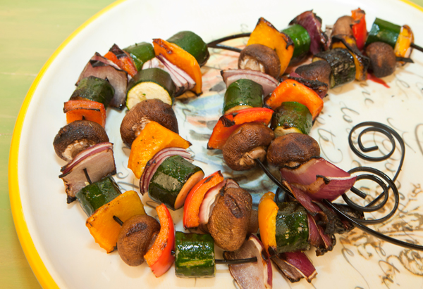 Threading mixed vegetables on skewers to be cooked over the grill is an easy way to prepare a tasty side dish.