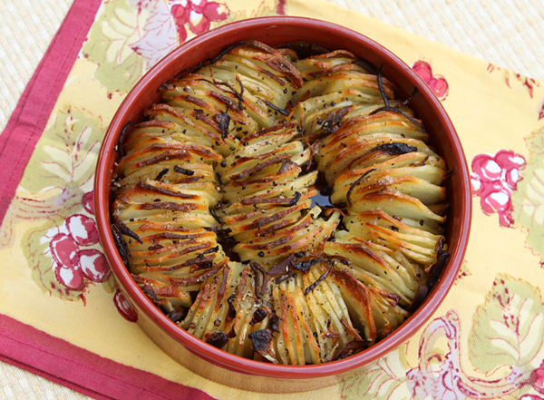 Crisp, golden brown potato slices seasoned with rosemary.
