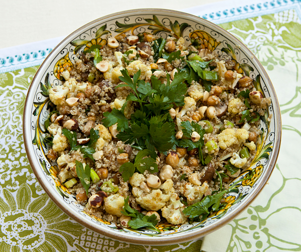 A healthy grain salad tossed with roasted cauliflower, garbanzo beans, & mushrooms.