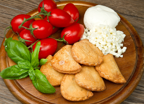 Crisp, golden brown fried pillows of dough stuffed with tomatoes and mozzarella.