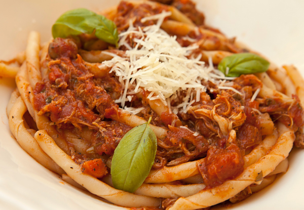 A meaty rabbit ragu prepared in the slow cooker.