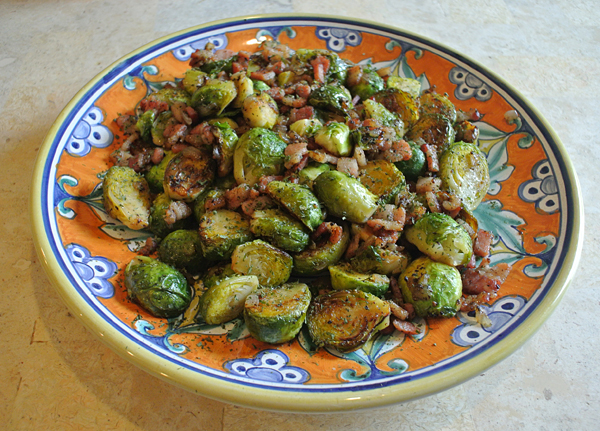 Pan frying Brussels sprouts with bacon creates a tasty side dish that would go well with roasted or grilled meat.