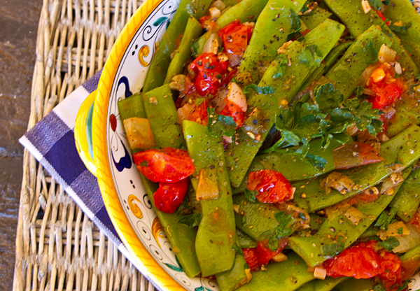 Pancetta, cherry tomatoes, and garlic turn ordinary green beans into an extraordinary vegetable side dish.