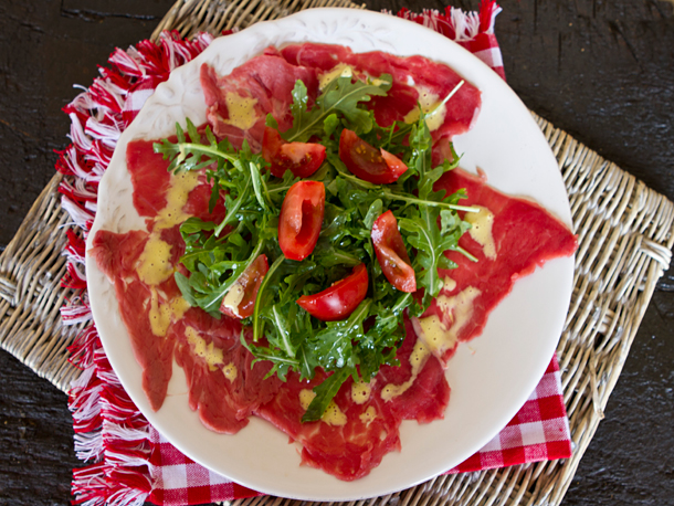 One of my favorite easy appetizers or light lunch entrees, beef carpaccio is very easy to make yourself at home!