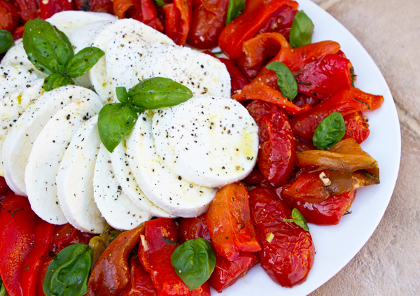 Creamy mozzarella is paired with meltingly tender oven roasted tomatoes and peppers in this gorgeous antipasto option.