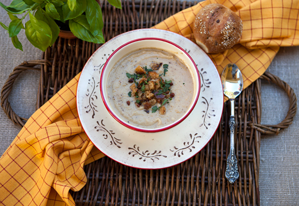 Roasting cauliflower for this creamy soup adds an earthy flavor that is very satisfying.
