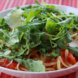 Spaghetti With Fresh Tomato Sauce & Arugula, And Shaved Pecorino Cheese