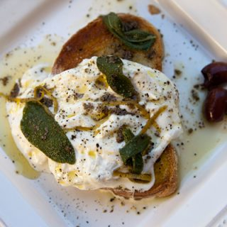 Buratta Cheese On Toasted Bread With Anchovy & Lemon Dressing