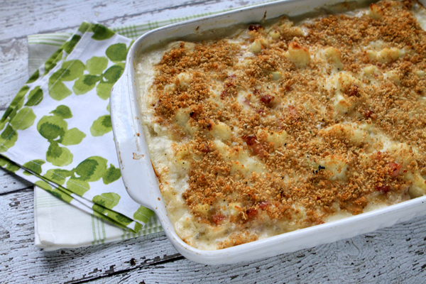 A creamy, cheesy sauce is tossed with cauliflower and then baked with a golden brown crumb topping.