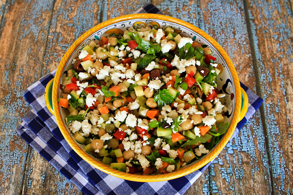 A combo of diced raw veggies are combined in this crunchy summer salad.