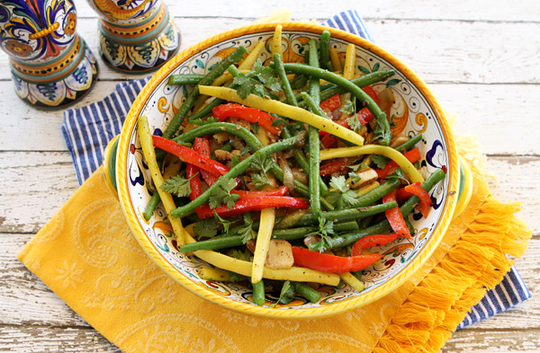 Tender, green beans are mixed with onions and peppers in this vibrant colored vegetable side dish.