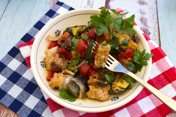 Grilling the stale bread before assembling this traditional Tuscan salad adds a smoky flavor.