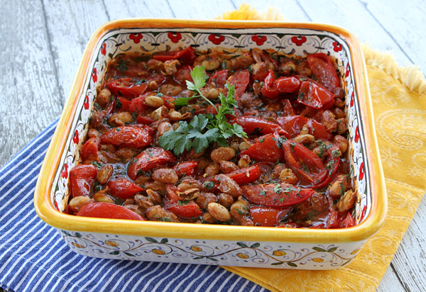 Baked canned beans with fresh tomatoes creates a tasty, light summer entree.