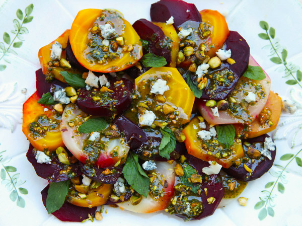 Sweet, roasted beets are topped with a nutty pesto sauce and blue cheese.