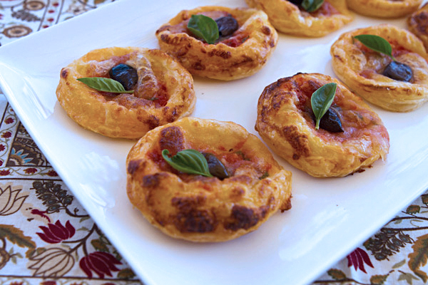This easy appetizer can be prepared in mere minutes using store bought puff pastry and will be enjoyed by the entire family.
