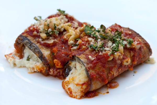 Thin eggplant slices are stuffed with a creamy cheese filling and are then baked topped with a tomato sauce.
