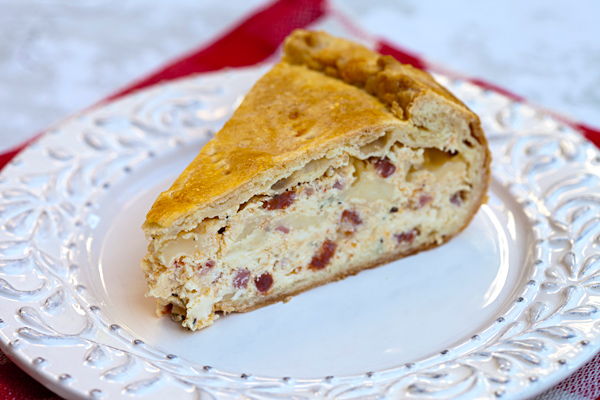 This traditional Easter tart recipe combines a creamy cheese and meat center encased in a bread crust.