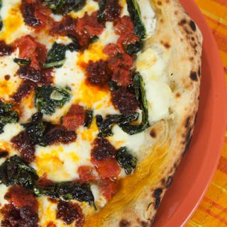 Pizza With Kale, Nduja, Tomatoes, & Robiola Cheese