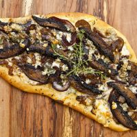 Flatbread With Caramelized Onions, Portobello Mushrooms, and Gorgonzola Crumbles