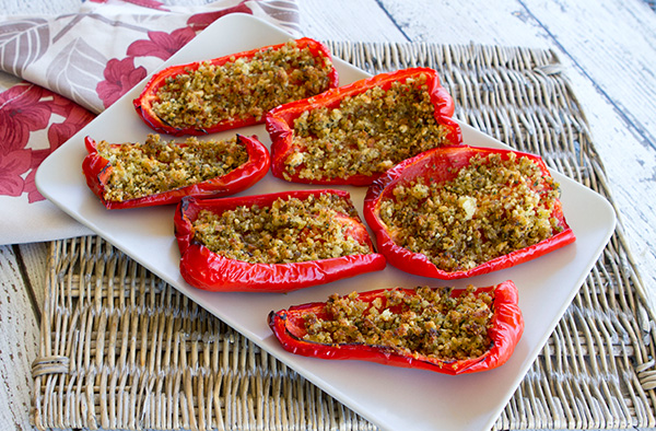 Tender pepper wedges are topped with a tasty crumb mixture in this typical appetizer.