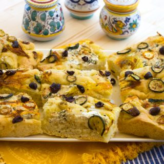 Focaccia With Zucchini, Zucchini Blossoms, Ricotta Cheese & Olives
