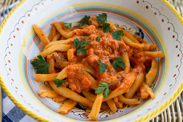A creamy pasta tomato sauce made with sausage that is perfect to top any type of pasta.