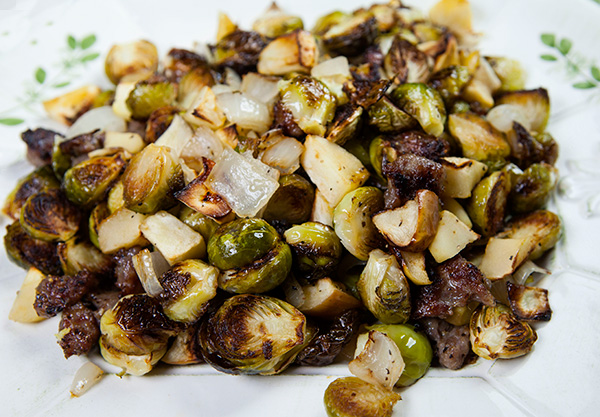 Roasting sprouts and apples together brings an earthy sweetness to this dish.