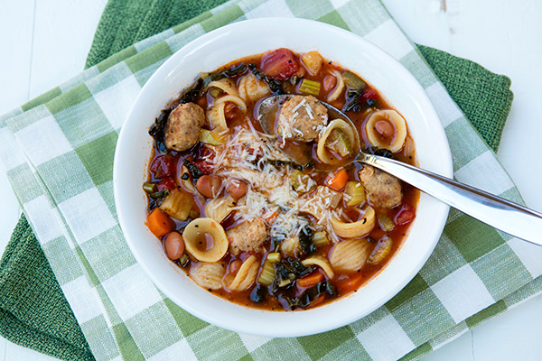 Tender meatballs added to a veggie filled minestrone creates a soup that the entire family will love.