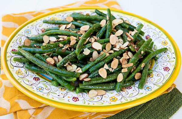 A vinbrant flavored dressing gives basic green beans new life.