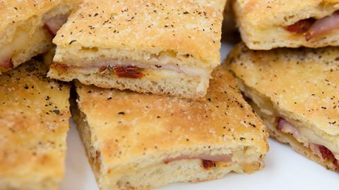 Focaccia Stuffed With Prosciutto Cotto Provolone Cheese Sun Dried Tomato Pesto Italian Food Forever