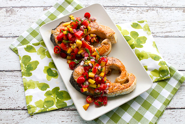 A fresh fruit relish tops grilled salmon steaks.