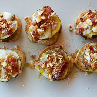 Bruschetta With Figs, Gorgonzola Cheese, Pancetta Crumbles, & Toasted Hazelnuts