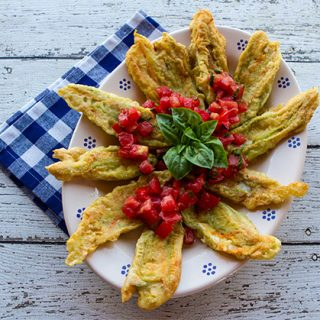 Pan Fried Zucchini Flowers Stuffed With Fontina Cheese