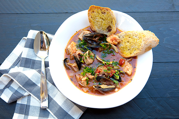 A mix of fresh seafood is used in this hearty seafood stew.