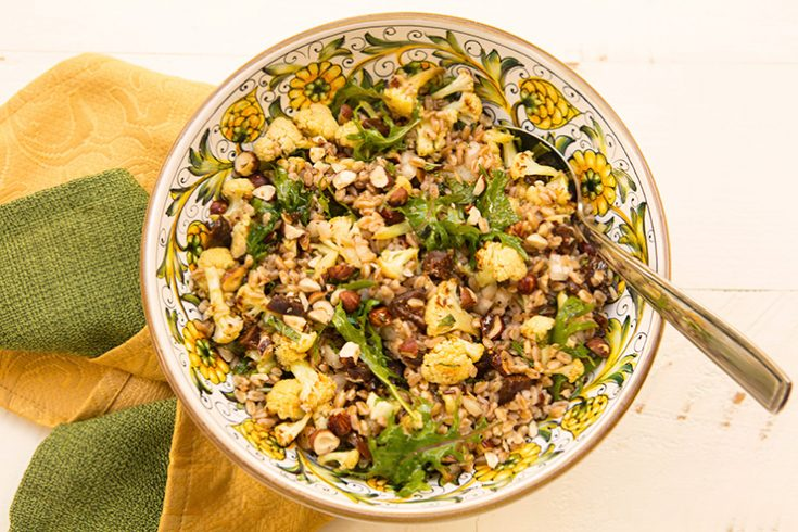 Earthy roasted cauliflower pairs with nutty farro in this hearty salad.