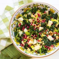 Kale, Barley, & Shredded Brussels Sprouts Salad With Pears, Walnuts, & Pomegranate Arils