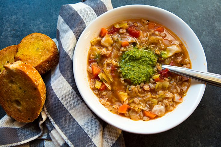 A hearty vegetarian soup enhanced with borlotti beans and farro.