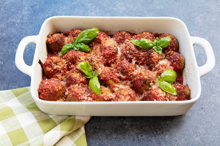 """Tender """"meatballs"""" made from eggplant and cannellini beans are cooked in a tasty tomato sauce."""