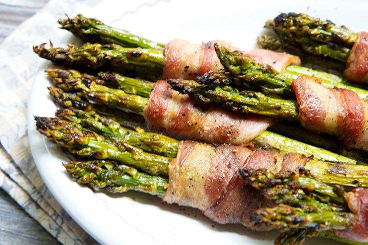 Grilling asparagus brings out its natural sweetness, while wrapping it in bacon gives it a salty twist.